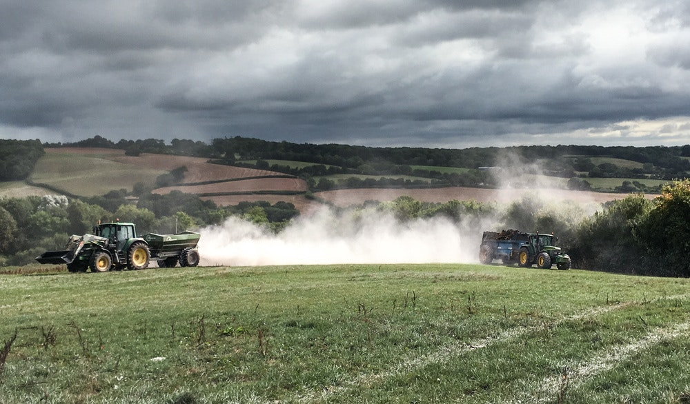 Muck and lime spreading looking spectacular due to the dramatic clouds