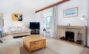 Very large sitting room with three sofas and two armchairs