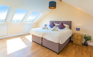 Shires - Bedroom 6 makes a great family room with the two extra beds