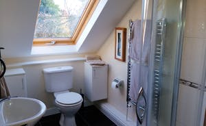En-suite to bedroom 1 power shower, toilet and basin