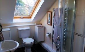En-suite to bedroom 1 power shower, toilet and basin