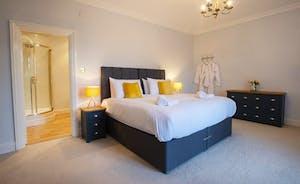 Sandfield House - Bedroom 2 has zip and link beds and an en suite shower room