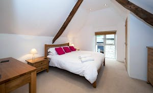 Siskins Nook, Stonehayes Farm: The bedrooms are all about space and calm; rustic features, restful interiors