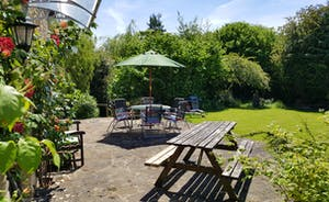 Kingfisher Cottage from the garden  - grass area, decking and patio