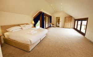Coat Barn - On the first floor, Bedroom 1 is spacious, light and airy and has an en suite bathroom