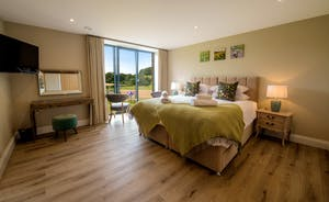 Croftview - Bedroom 7 (Kingfisher) is on the first floor and has an en suite bathroom