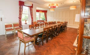 Peak Manor - Parquet flooring and wood paneling in the formal Dining Room