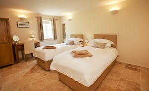 Holemoor Stables - Bedroom 1 can have a super king or twin beds and has an ensuite shower room