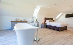 The Granary - Bedroom 9 has a free standing bath with views from the French doors and Juliette balcony. It also has an en suite shower room
