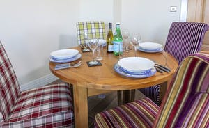 Dining area seating four guests