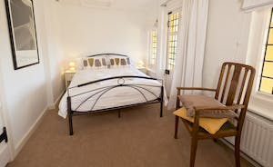 The Benches -  Bedroom 4 has a double bed, an en suite shower room and access to the balcony overlooking the pool