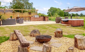 Sit and relax around the fire pit of an evening