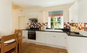 Kitchen / Dining Romm with oak table and floor