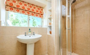 The En-Suite Shower Room to master bedroom with views of the garden