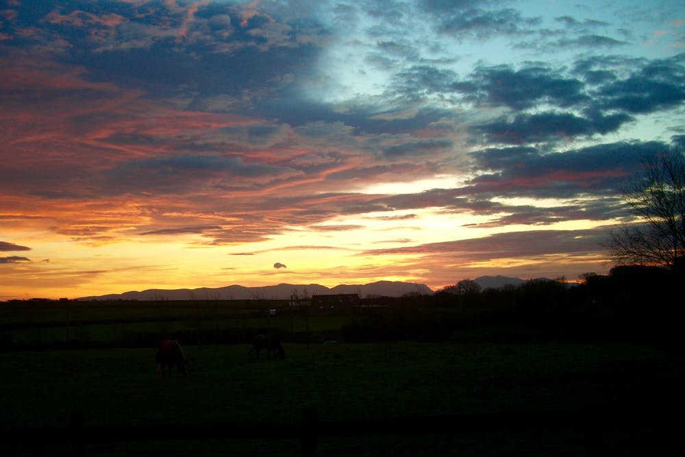 Beautiful sunrise over Snowdonia from Bodfan, Anglesey