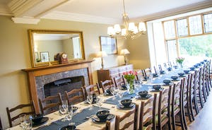Bossington Hall - A huge refectory dining table seats all 30 guests for a lavish dinner
