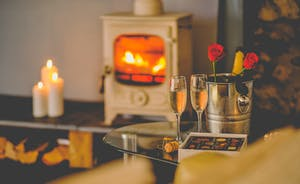 A perfect welcome candles lit cosy cottage with bubbly on ice waiting for your arrival