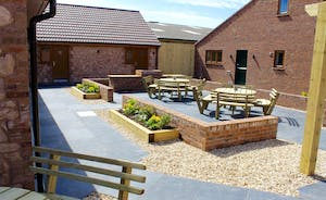 Quantock Barns - All barns are accessed via a paved courtyard, with outdoor seating and a big built in barbecue