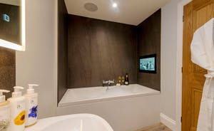 Kingshay Barton - Bedroom 4 (Coombe) has an en suite bathroom with a built-in TV