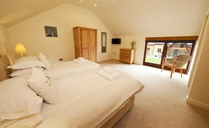Coat Barn - Bedroom 2 is on the first floor and has an en suite bathroom