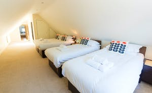 Ramscombe - Bedroom 4 is a super family room with an en suite shower room