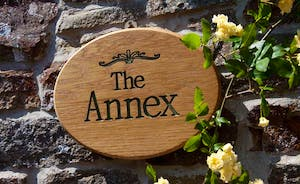 The Annex Sign with Roses