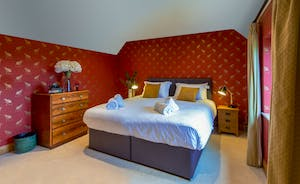 Dancing Hill  - Bedroom 2: Gold and red wallpaper gives an opulent feel to the room