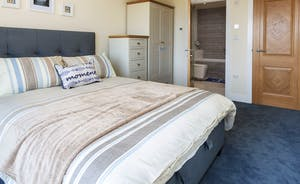 Bedroom 2 with ample storage and en suite