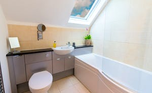 Siskins Nook, Stonehayes Farm - The bathroom has a P-bath with an overhead shower