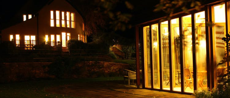 The Cottage Beyond and Spa Hall at night.