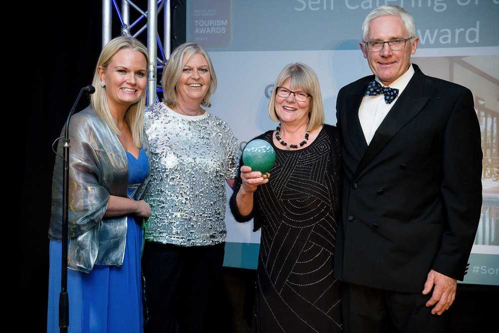 Christine & Alan being presented with the Gold Award for Self-catering at The Bristol, Bath & Somerset Awards