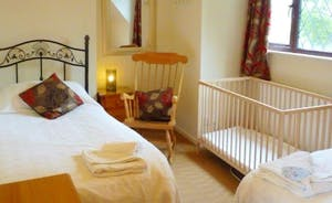 Upstairs twin bedroom, with fully size cot available