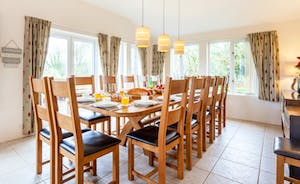 Large oak dining table seating 14 comfortably on solid oak chairs