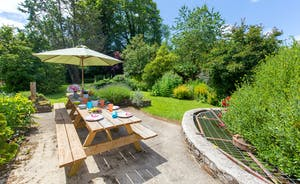 Culmbridge House - The lovely mature garden is the perfect backdrop to a family meal alfresco