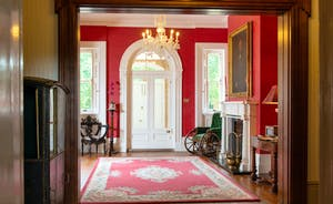 Severn Manor - Rich red hues give the reception hall a warm ambience