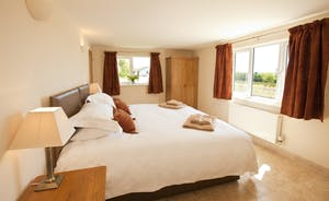 Holemoor Stables - Bedroom 7; a bright and airy room with an en suite bathroom