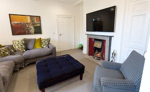 Pitmaston House - The cosy snug with an open fireplace and big TV - light the fire, curl up and watch a movie