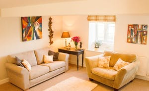 "Snuggle in to the second sitting room with 42"" Smart TV, Sky Movies/Sports, deep pile rugs, large comfy sofas"