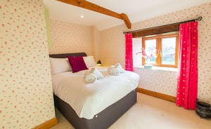 Dancing Hill  - Bedroom 4: A pretty room with an outlook over the front garden and the countryside beyond