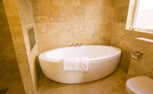 Ham Bottom - Bedroom 3: a contemporary free standing bath and a separate wet area for the shower