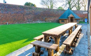 Beaverbrook 20 - Chunky rustic garden seating in the walled garden