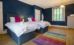 Sandfield House - Bedroom 6 is a colourful room on the ground floor