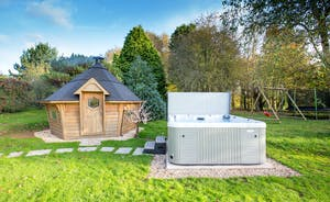 Ilbeare - Well, that's a BBQ lodge, a hot tub AND children's play equipment - fun for all ages!