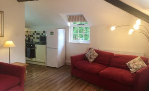 The lounge is open to the kitchen dining area
