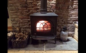 RELAX WITH A GOOD GIN IN FRONT OF THE WOODBURNER