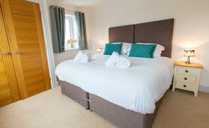 Orchard View - Bedroom 3: Zip and link beds means you can have a superking or two singles