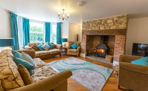 Culmbridge House - A cosy living room with sofas to curl up on, and if it's chilly you can light the wood-burner