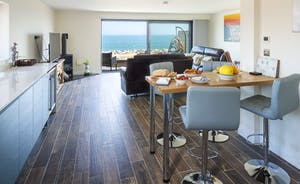 Enjoy sea views from every corner of the living/dining area