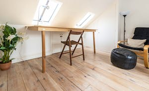 The mezzanine over the master bedroom has a folding desk so can be used as a study