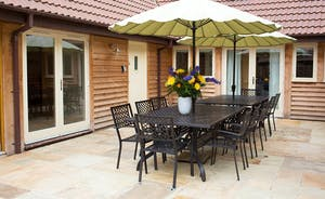 Ramscombe - A big patio table to seat 14 is great for barbecue and alfresco dining